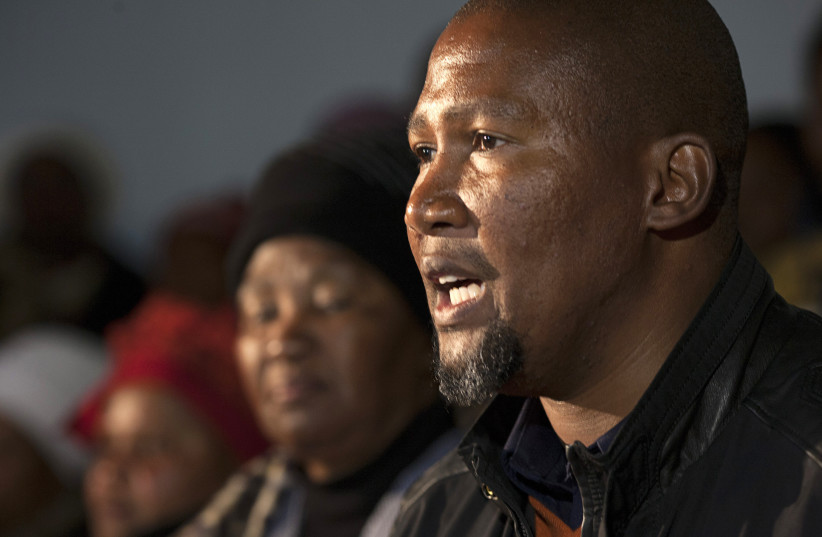 Mandla Mandela, grandson of Nelson Mandela, speaks to reporters in South Africa (photo credit: SIEGFRIED MODOLA/REUTERS)