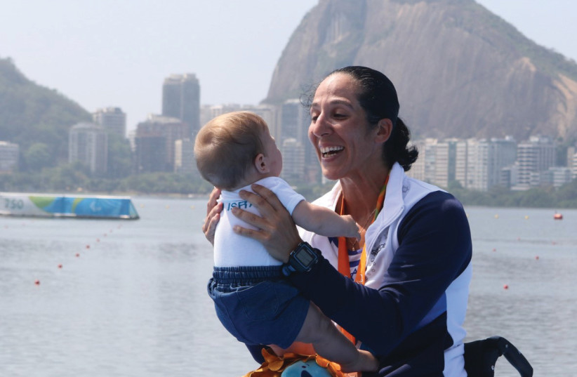 Moran Samuel with her son, Arad, at the Rio Paralympics in 2016 (photo credit: DETLEV SEYEB / KEREN ISAACSON)