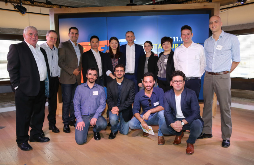 Officials from the Ministry of Economy meet with entrepreneurs from the selected start-ups, along with executives from the Shengjing Group and DayDayUp in Tel Aviv. (photo credit: COURTESY EZRA LEVY)