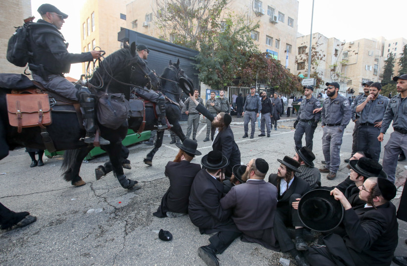 Haredi men protest outside the draft office in Jerusalem on November 28. (photo credit: MARC ISRAEL SELLEM)