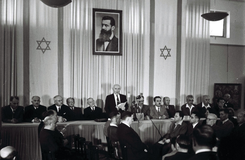 DAVID BEN-GURION reads the declaration of Israel's independence in Tel Aviv in 1948 (photo credit: KLUGER ZOLTAN/GPO)