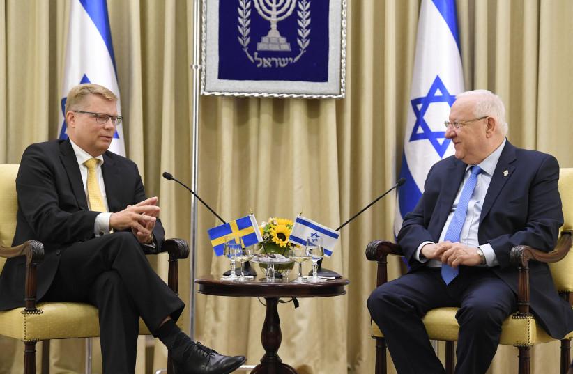 Israeli President Reuven Rivlin and Sweden's new ambassador to Israel Magnus Hellgren. (photo credit: Mark Neiman/GPO)