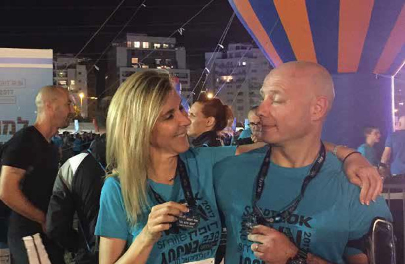 Sara Omer and her friend Stewart Taylor after they completed the 10K TLV Night Run in October (photo credit: Courtesy)