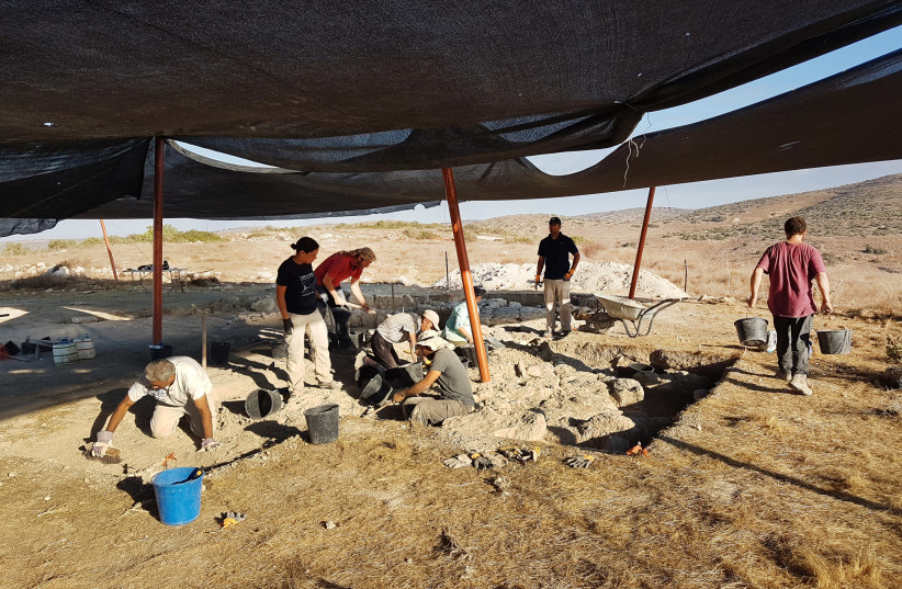 Archeologists unearth the structure.  (photo credit: MICHAL HABER/IAA)