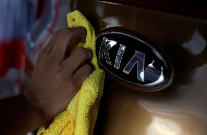 The logo of KIA Motor at car dealership (photo credit: REUTERS/DANIEL BECERRIL)