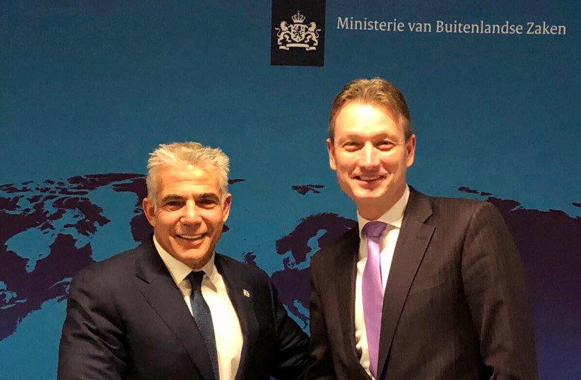 Yesh Atid Chairman Yair Lapid meets in Amsterdam Thusday with Dutch foreign minister Halbe Zijlstra. (photo credit: Courtesy)