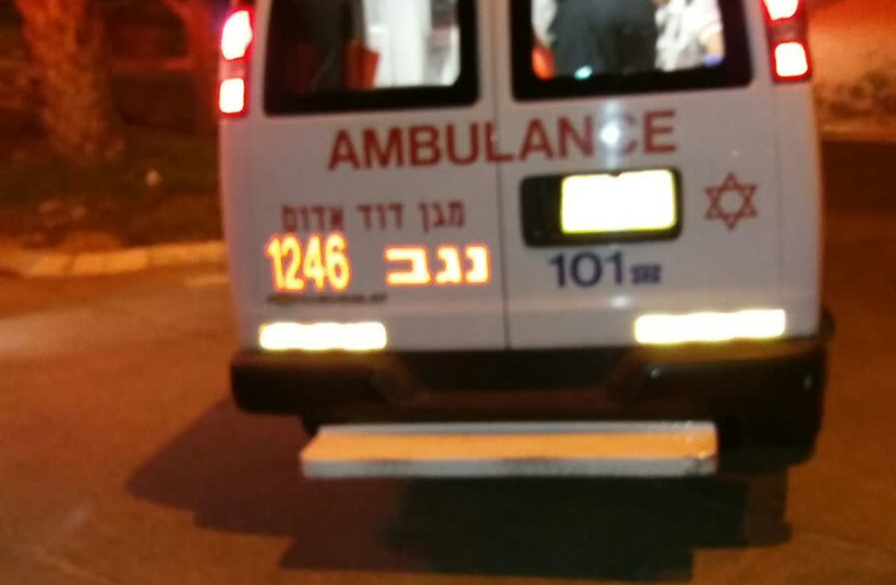 An MDA ambulance leaves the scene of a suspected terror attack in Arad on November 30. (photo credit: MAGEN DAVID ADOM)