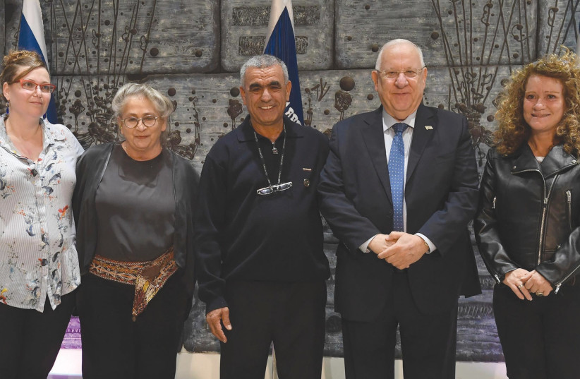 PRESIDENT REUVEN RIVLIN and his wife, Nechama (second from left), host (from left) Vered Shirazi, Adnan Haj Yihye and Michal Vitori yesterday during an event at the President's Residence encouraging organ donations. (photo credit: MARK NEYMAN/GPO)