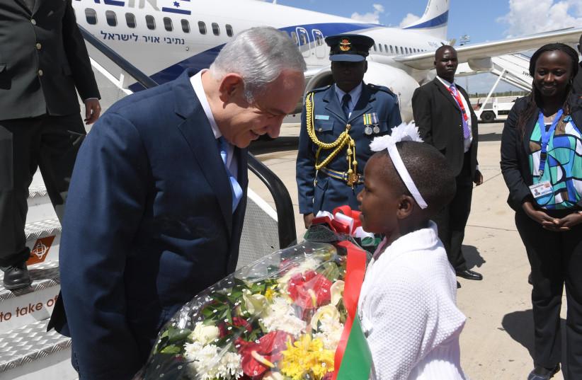 PRIME MINISTER Benjamin Netanyahu gets a warm welcome at the airport in Nairobi, where he flew this past week to attend the re-inauguration of Kenya's President Uhuru Kenyatta.  (photo credit: CHAIM TZACH/GPO)
