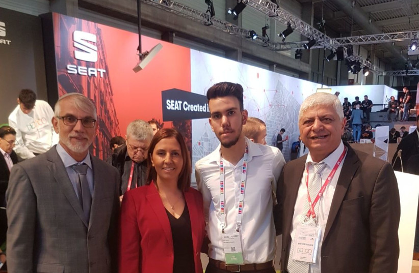 16-year-old entrepreneur Eli Ohayon displayed his fitness start-up at an exposition in Barcelona last month. Accompanying Ohayon were Minister for Social Equality Gila Gamliel (center-left) Ma'aleh Adumim Mayor Benny Kashriel (far-right), and Bat Yam city councilman Uri Buskila (far-left). (Credit:  (photo credit: Courtesy)