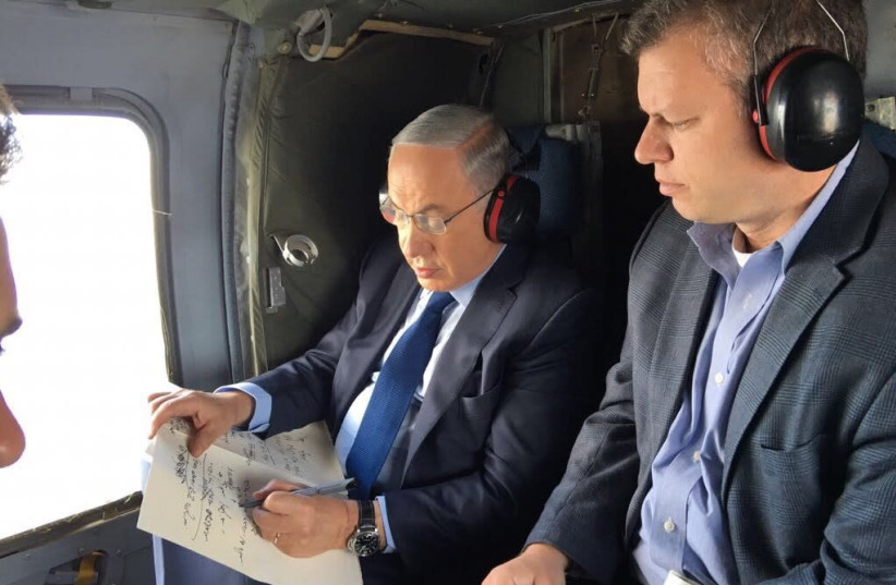 Eli Groner, director general of the PMO, with Benjamin Netanyahu on a recent helicopter flight (photo credit: Courtesy)