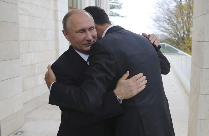Russian President Vladimir Putin welcomes Syrian President Bashar Assad in the Black Sea resort of Sochi this month (photo credit: SPUTNIK/MIKHAIL KLIMENTYEV/KREMLIN VIA REUTERS)