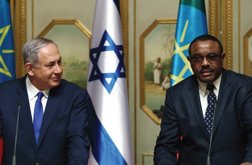 PRIME MINISTER Benjamin Netanyahu and his Ethiopian counterpart Hailemariam Desalegn address a news conference at the National Palace during his State visit to Addis Ababa. (photo credit: REUTERS)