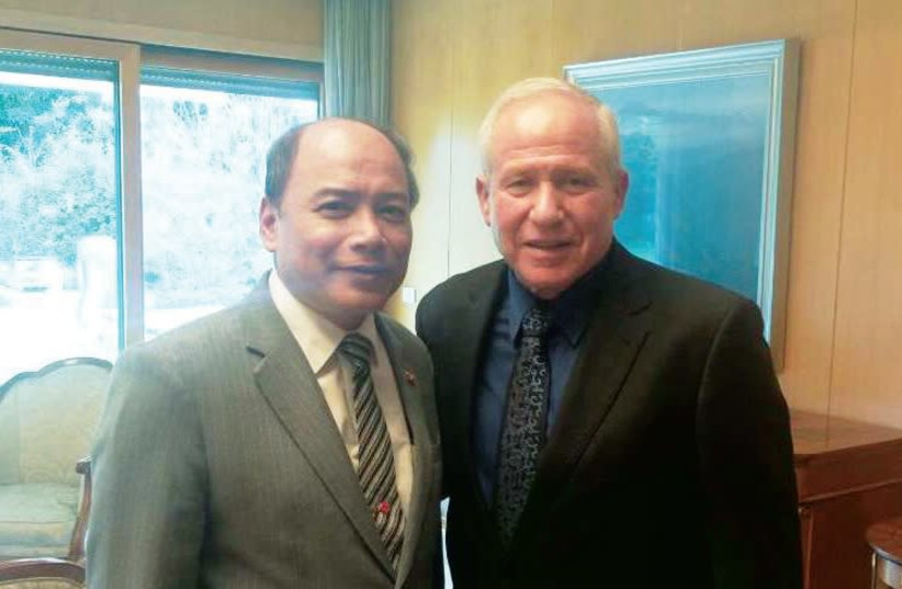 MYANMAR AMBASSADOR U Maung Maung Lynn (left) poses with Chairman of the Foreign Affairs and Defense Committee Avi Dichter last month. (photo credit: Courtesy)