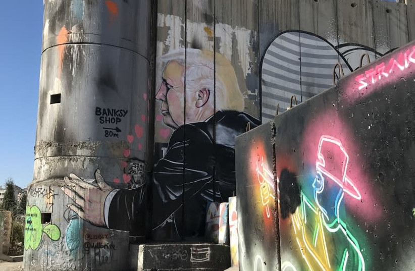 A portion of the separation wall in Bethlehem has become a destination for graffiti artists (photo credit: SETH J. FRANTZMAN)