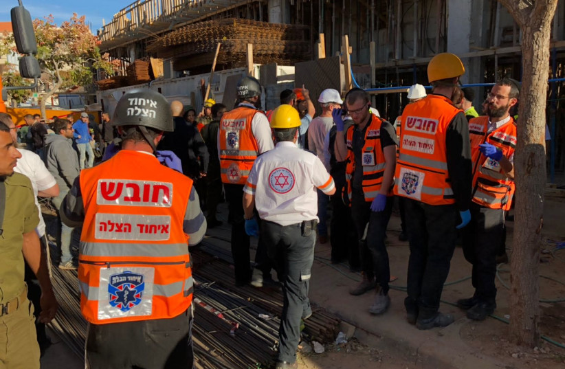 Emergency personnel survey the site of a building collapse in Beitar Illit on December 4th.  (photo credit: COURTESY UNITED HATZALAH)