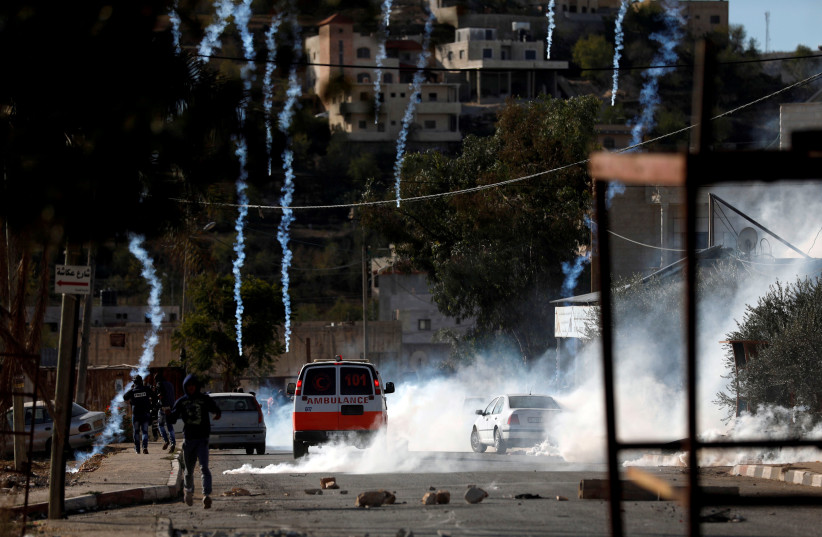 Palestinians clash with Israeli troops in the West Bank village of Kusra (photo credit: MOHAMAD TOROKMAN/REUTERS)