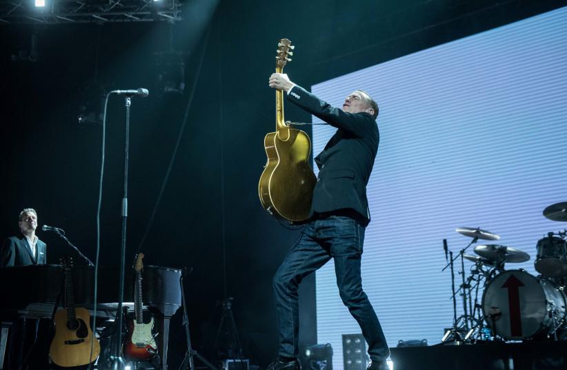 Bryan Adams performs at the Menorah Mivtachim Arena in Tel Aviv, December 4, 2017 (photo credit: LIOR KETER)