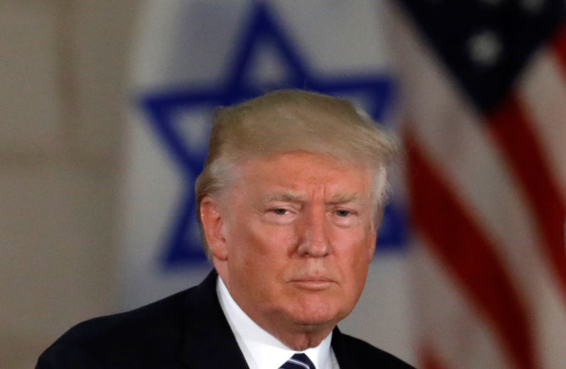 President Donald Trump, near an Israeli flag at the Israel Museum in Jerusalem (photo credit: REUTERS/Ronen Zvulun)