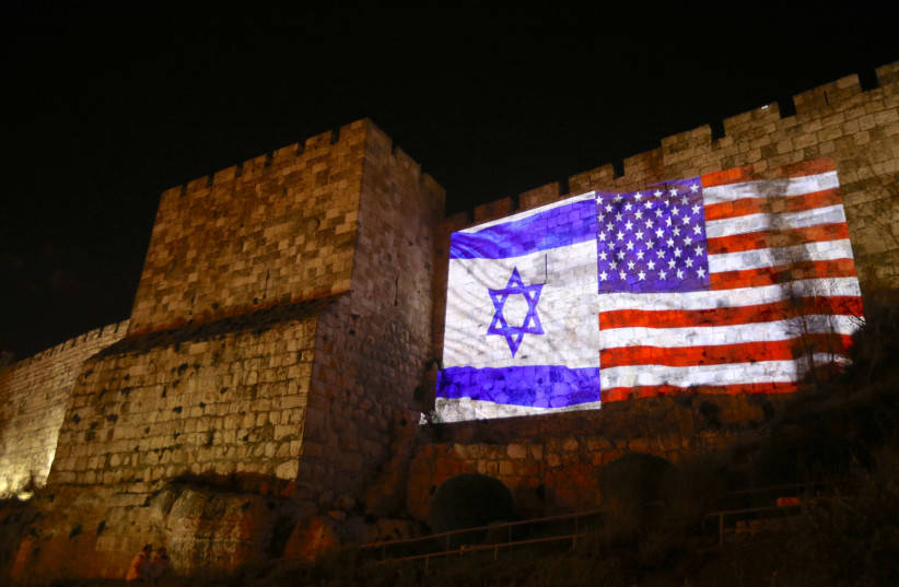 US and Israeli flags beaming onto Jerusalem wall side-by-side (photo credit: MARC ISRAEL SELLEM/THE JERUSALEM POST)