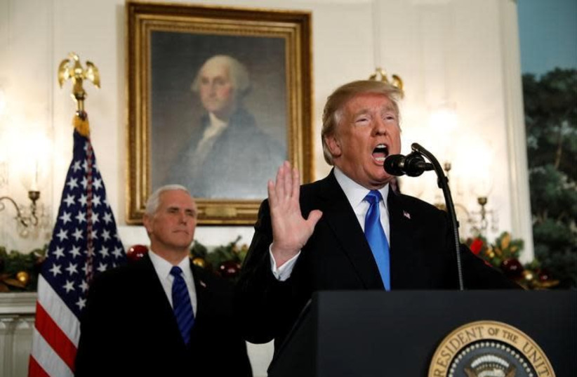 With Vice President Mike Pence looking on, US President Donald Trump gives a statement on Jerusalem, during which he recognized Jerusalem as the capital of Israel, in the Diplomatic Reception Room of the White House in Washington, US, December 6, 2017 (photo credit: REUTERS/KEVIN LAMARQUE)
