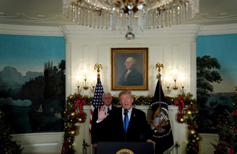 US President Donald Trump, flanked by Vice President Mike Pence, delivers remarks recognizing Jerusalem as the capital of Israel at the White House in Washington, US December 6, 2017. (photo credit: JONATHAN ERNST / REUTERS)