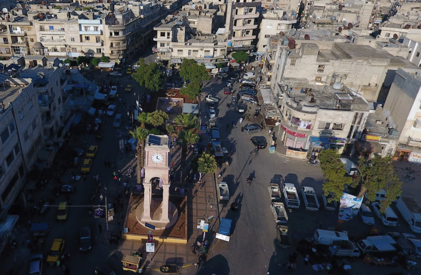 A GENERAL view taken with a drone shows the Clock Tower of the rebel-held Idlib city, Syria in June. (photo credit: REUTERS)