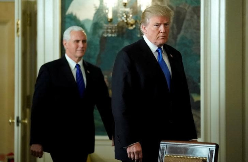 US President Donald Trump and Vice President Mike Pence arrive for Trump to deliver remarks recognizing Jerusalem as the capital of Israel at the White House in Washington, US December 6, 2017 (photo credit: REUTERS/JONATHAN ERNST)