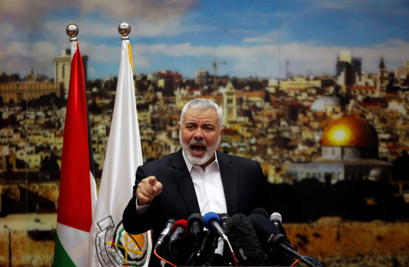 Hamas Chief Ismail Haniyeh gestures as he delivers a speech over U.S. President Donald Trump's decision to recognize Jerusalem as the capital of Israel, in Gaza City December 7, 2017 (photo credit: MOHAMMED SALEM/REUTERS)