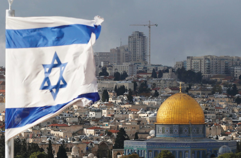 AN ISRAELI flag near the Dome of the Rock in Jerusalem's Old City. (photo credit: REUTERS)