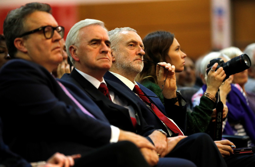 Leader of the opposition Jeremy Corbyn, Shadow Finance Minister John McDonnell and deputy leader of the Labour Party Tom Watson, November 23, 2017 (photo credit: REUTERS)