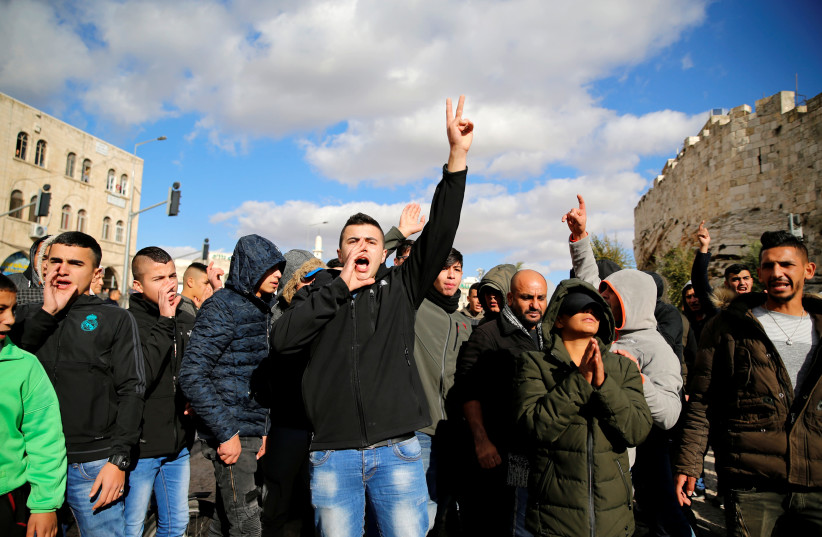 Palestinians in the Old City of Jerusalem shout slogans in protest against US recognition of Jerusalem (photo credit: AMMAR AWAD / REUTERS)