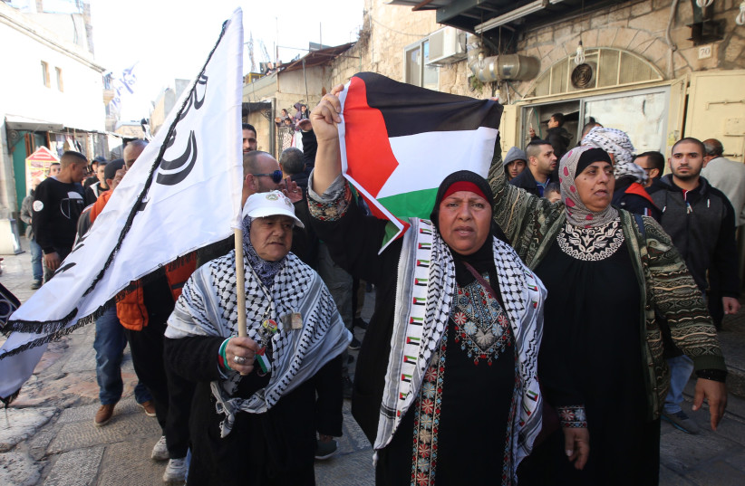 Palestinian protestors rally against US President Donald Trump's recognition of Jerusalem as Israel's capital. (photo credit: MARC ISRAEL SELLEM)