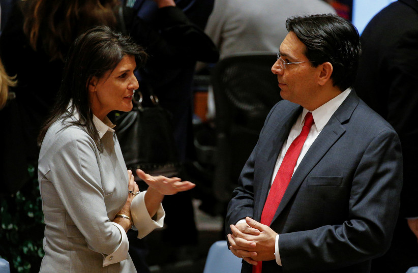 United States ambassador to the United Nations Nikki Haley speaks with Israel's Ambassador to the UN Danny Danon before the start of a UN Security Council meeting on Jerusalem and Palestine in 2017. (photo credit: REUTERS)