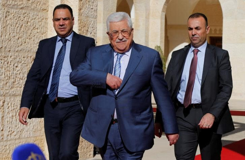 Palestinian Authority President Mahmoud Abbas walks to speaks to the media after his meeting with Jordan's King Abdullah at the Royal Palace in Amman, Jordan October 22, 2017 (photo credit: REUTERS/MUHAMMAD HAMED)