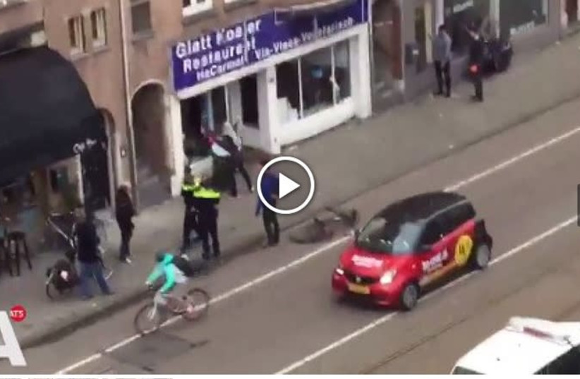 Screenshot of AT5 site with video of Palestinian man attacking Kosher resturant in Amsterdam (photo credit: screenshot)