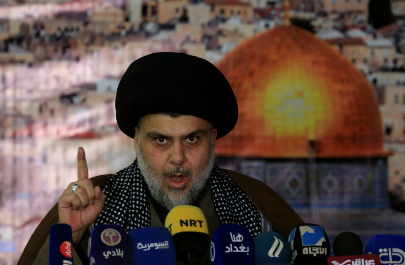 Iraqi Shi'ite Muslim leader Moqtada al-Sadr gestures as he delivers a speech over US President Donald Trump's decision to recognize Jerusalem as the capital of Israel, in Baghdad, Iraq December 7, 2017. (photo credit: REUTERS)