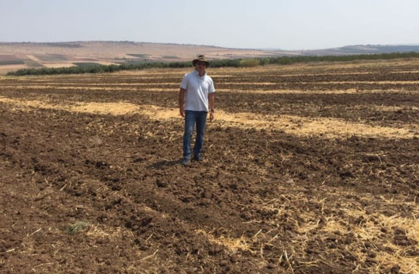 David Tavdi walks on farmland in Israel (photo credit: Courtesy)