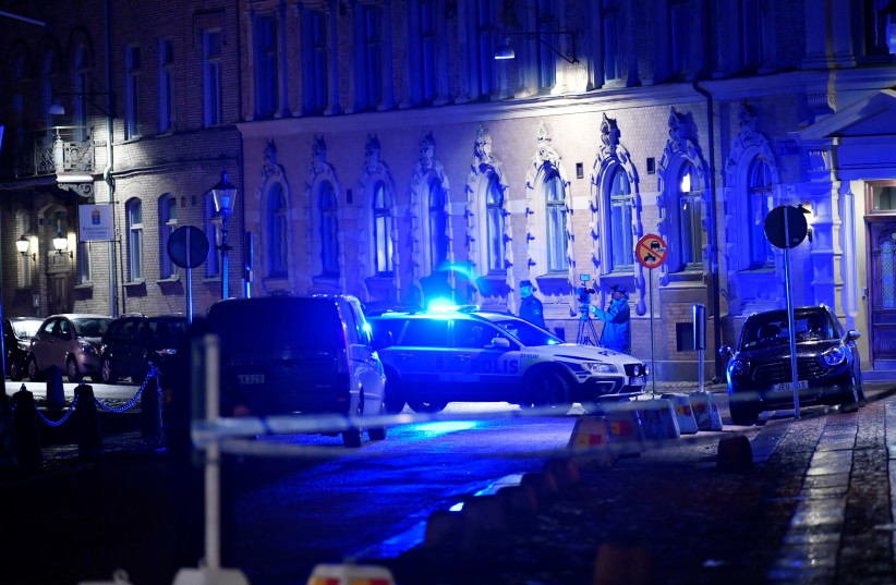 Police is seen at the site of an attack near a synagogue in Gothenburg, Sweden December 9, 2017 (photo credit: TT NEWS AGENCY/ADAM IHSE/VIA REUTERS)