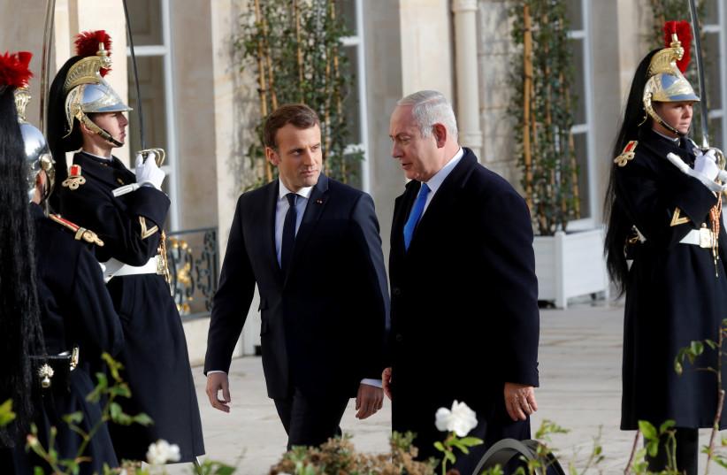 French President Emmanuel Macron welcomes Israeli Prime Minister Benjamin Netanyahu in Paris (photo credit: PHILIPPE WOJAZER / REUTERS)