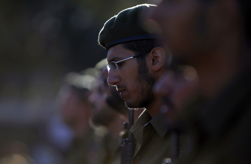 An Israeli soldier of the Ultra-Orthodox brigade takes part in a swearing-in ceremony in Jerusalem. (photo credit: REUTERS)