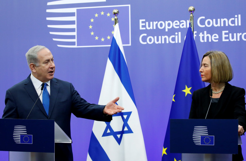 Netanyahu and EU foreign policy chief Mogherini brief the media in Brussels (photo credit: REUTERS/FRANCOIS LENOIR)