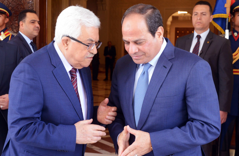 A handout picture provided by the PPO shows Egyptian President Abdel Fattah al-Sisi meeting with Palestinian leader Mahmoud Abbas in Cairo on May 9, 2016 (photo credit: AFP PHOTO / PPO / THAER GHANAIM)