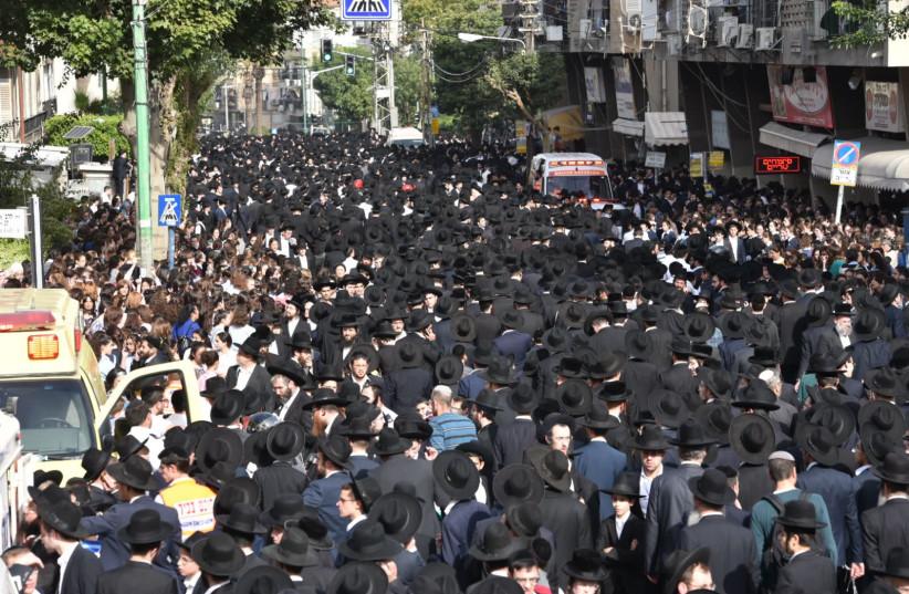 Haredim (ultra-Orthodox) walk through Bnei Brak during the funeral procession of Rabbi Aharon Leib Shteinman. (photo credit: COURTESY ISRAEL POLICE)