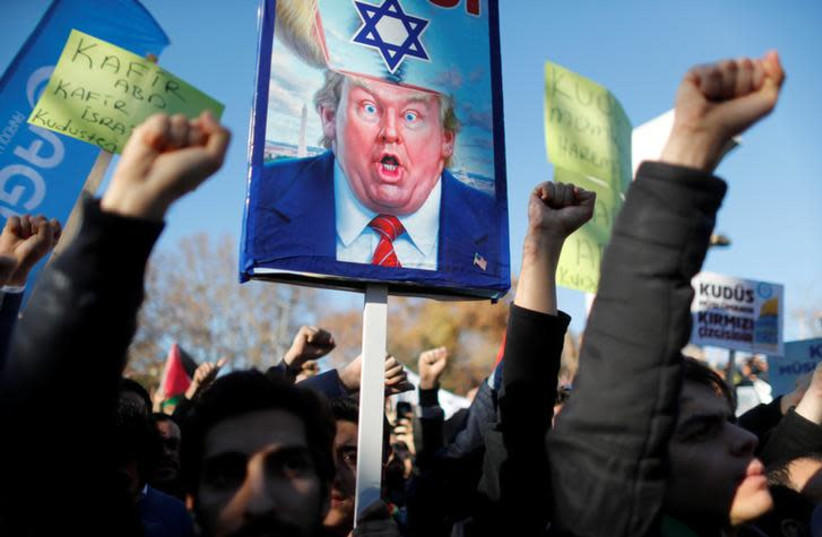 Demonstrators shout slogans during a protest against U.S. President Donald Trump's recognition of Jerusalem as Israel's capital, in Istanbul, Turkey December 8, 2017.  (photo credit: REUTERS/OSMAN ORSAL)