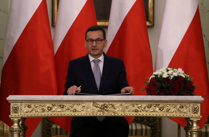 Polish Prime Minister Mateusz Morawiecki reacts after receiving his nomination during a government swearing-in ceremony in Warsaw, Poland, December 11, 2017. (photo credit: AGENCJA GAZETA/SLAWOMIR KAMINSKI VIA REUTERS)