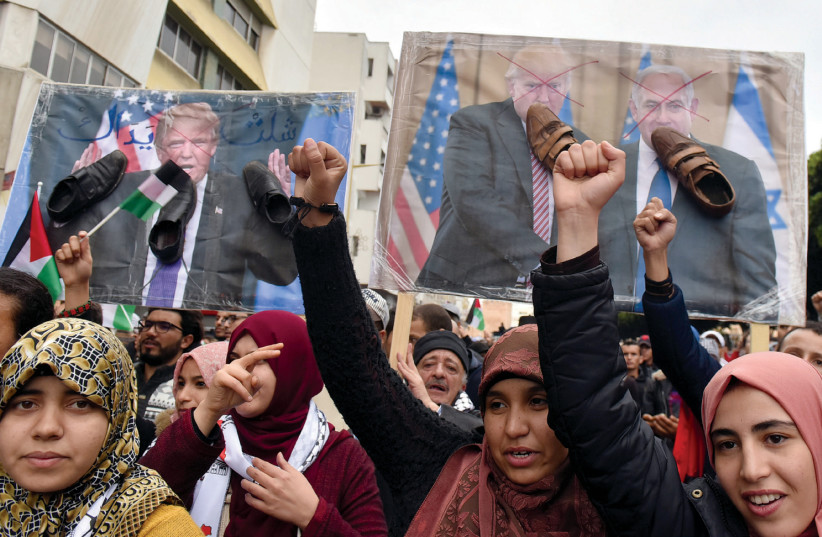 DEMONSTRATORS SHOUT slogans during a protest against the US intention to move its embassy to Jerusalem and to recognize the city of Jerusalem as the capital of Israel, in the city of Rabat, Morocco, earlier this week (photo credit: REUTERS)
