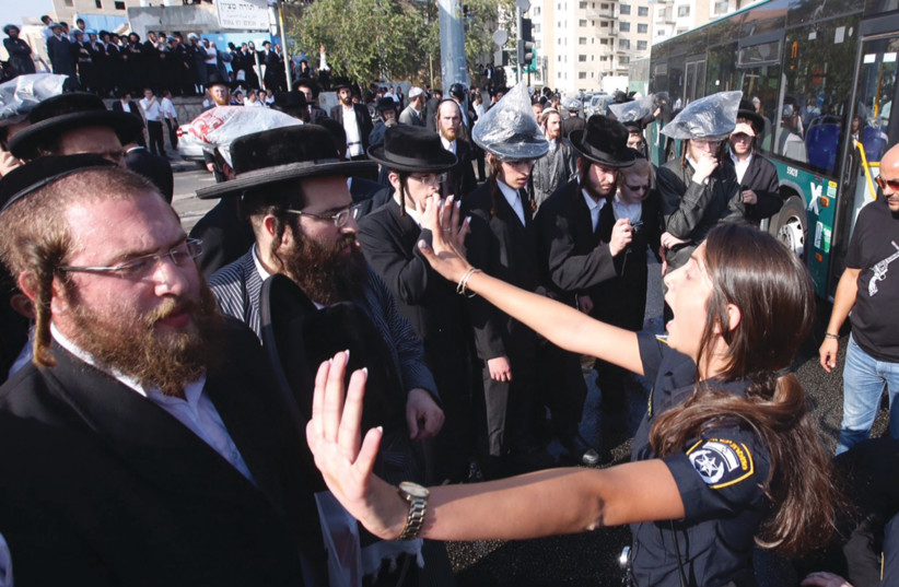 Haredi rioters affiliated with extremist communities block traffic at a Jerusalem junction (photo credit: MARC ISRAEL SELLEM)