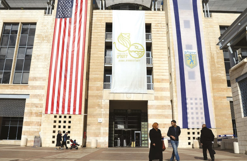 US AND Israel flags displayed in Jerusalem after Washington recognized Jerusalem as the capital. (photo credit: REUTERS)