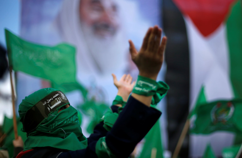 A Palestinian woman supporting Hamas takes part in a rally marking the 30th anniversary of Hamas' founding, in Gaza City December 14, 2017 (photo credit: SUHAIB SALEM / REUTERS)